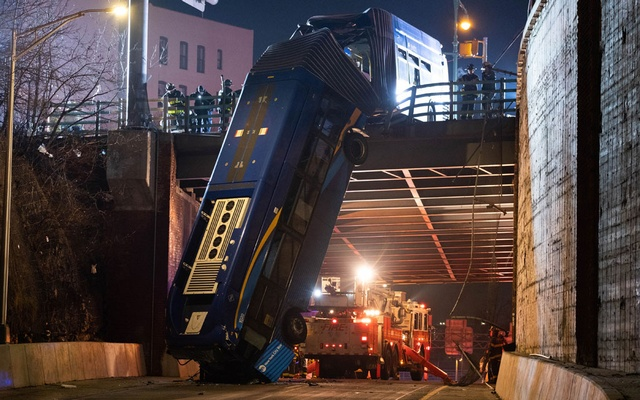 New York City bus left dangling from overpass after crash