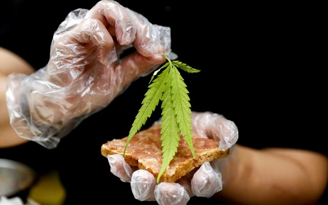 A chef prepares a pork sandwich with a marijuana leaf at Abhaibhubejhr hospital canteen which adds cannabis-infused dishes to its menu in Thailand, January 15, 2021. Reuters