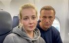 Kremlin critic Navalny takes off on plane to Russia despite arrest threat
