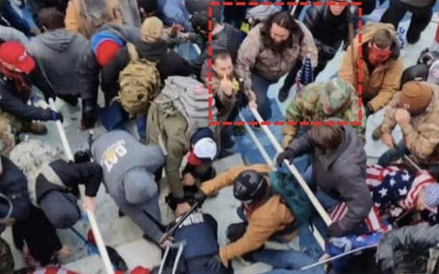 A photo provided by the United States District Court for the District of Columbia, of Peter Francis Stager, outlined in red by source, during a riot at the Capitol in Washington on Jan. 6, 2021. He is accused of using a flagpole