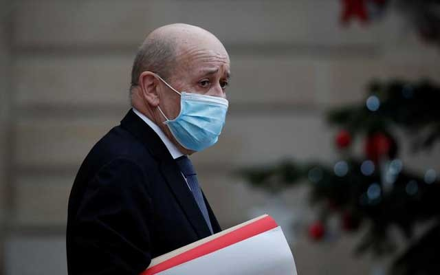 FILE PHOTO: French Foreign Minister Jean Yves Le Drian, wearing a protective face mask, leaves following the weekly cabinet meeting at the Elysee Palace in Paris, France, January 6, 2021. REUTERS