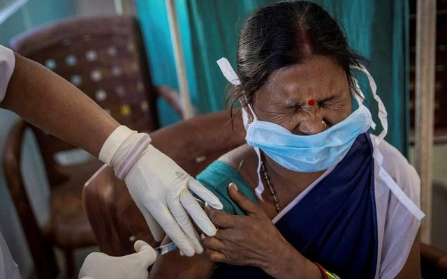 A healthcare worker reacts as she receives a dose of COVISHIELD, a COVID-19 vaccine manufactured by Serum Institute of India, during one of the world's largest COVID-19 vaccination campaigns at Mathalput Community Health Centre in Koraput district of the eastern state of Odisha, India, January 16, 2021. Reuters