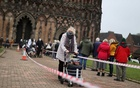 People queue to receive their COVID 19 vaccines inside Lichfield Cathedral which had been turned into an emergency vaccination centre, amid the coronavirus disease (COVID-19) outbreak, in Lichfield, in Birmingham, Britain, January 15, 2021. REUTERS