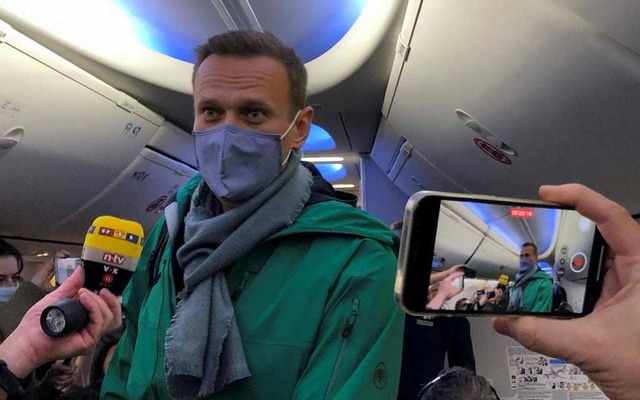 Russian opposition leader Alexei Navalny is seen on board a plane before the departure for the Russian capital Moscow at an airport in Berlin, Germany January 17, 2021. Reuters
