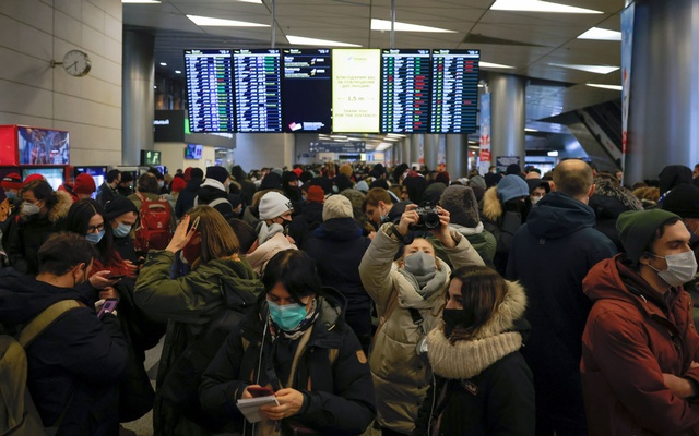 People gather in a terminal before the expected arrival of Russian opposition leader Alexei Navalny on a flight from the German capital Berlin at Vnukovo International Airport in Moscow, Russia January 17, 2021. Handout via REUTERS