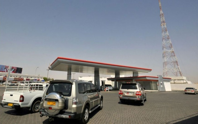 Cars line up at a petrol station in Al Buraimi near Oman's border with the UAE. Reuters