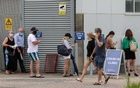 People wait in line at a coronavirus disease (COVID-19) testing clinic at Mona Vale Hospital in the wake of a new outbreak in the Northern Beaches area of Sydney, Australia, December 18, 2020. REUTERS