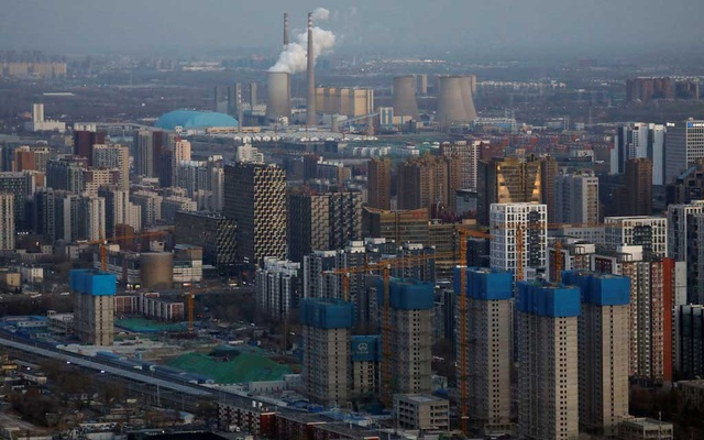 Residential buildings under construction and a power station are seen near the central business district in Beijing, China, January 15, 2021. REUTERS