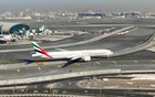 Emirates airliners are seen on the tarmac in a general view of Dubai International Airport in Dubai, United Arab Emirates January 13, 2021. REUTERS