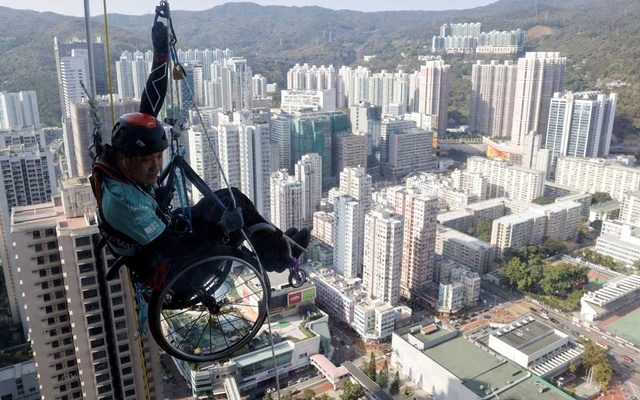Lai Chi-wai, a paraplegic climber, attempts to climb the 320-metre tall Nina Tower using only his upper body strength, in Hong Kong, China January 16, 2021.