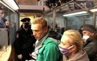Navalny lands in Moscow after plane diverted