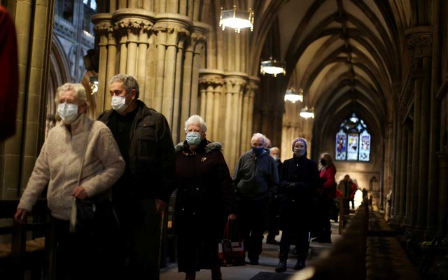 People queue to receive COVID-19 vaccines inside Lichfield Cathedral, which has been turned into an emergency vaccination centre, amid the coronavirus disease (COVID-19) outbreak, in Lichfield, in Birmingham, Britain, Jan 15, 2021. REUTERS