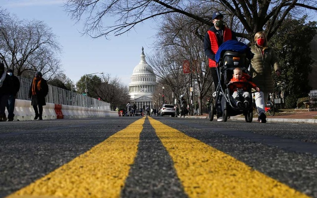 People try to see the Capitol as streets are blocked for security reasons ahead of US President-elect Joe Biden's inauguration, in Washington, US, January 16, 2021. REUTERS