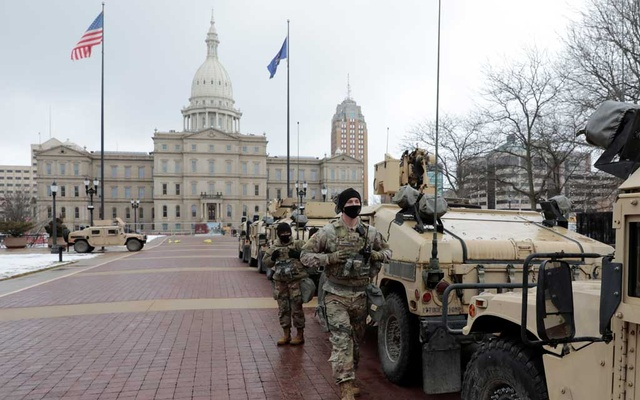 National Guard members stand guard outside the Michigan State Capitol ahead of US President-elect Joe Biden's inauguration, in Lansing, Michigan, US, January 17, 2021. REUTERS