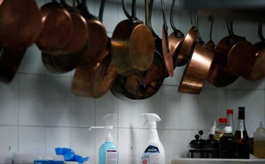 Bottles of disinfectant and hydroalcoholic solution are seen in the kitchen at Michelin-starred restaurant Le Chiberta in Paris before the announcement by the French government t of more easing lockdown measures to allow the reopening of restaurants as soon as possible following the outbreak of the coronavirus disease (COVID-19) in France, May 27, 2020. REUTERS