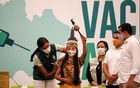 Vanderlecia Ortega dos Santos, or Vanda, from the Witoto indigenous tribe, receives the Sinovac coronavirus disease (COVID-19) vaccine, in Manaus, Brazil Jan 18, 2021. REUTERS