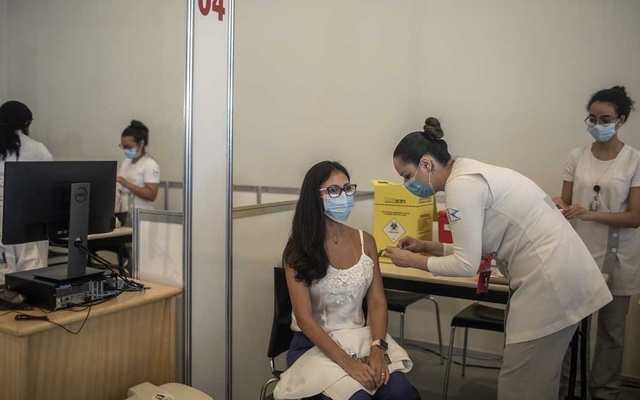 A health care worker receives a CoronaVac COVID-19 vaccination in Sao Paulo, Brazil, on Monday, Jan 18, 2021. The New York Times