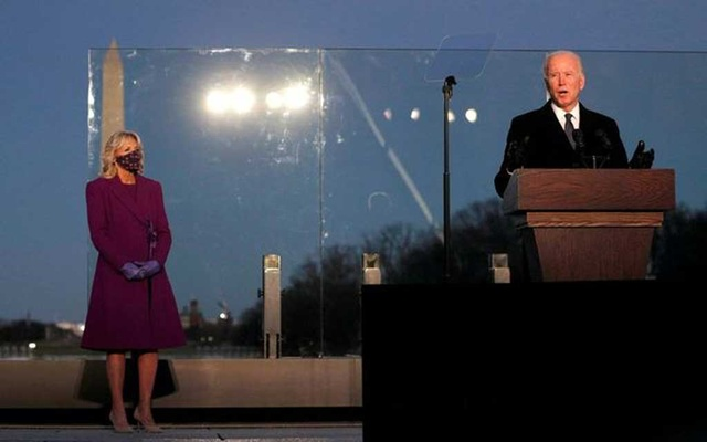 FILE PHOTO: US President-elect Joe Biden delivers remarks at a coronavirus disease (COVID-19) memorial event at the Lincoln Memorial in Washington, US January 19, 2021. REUTERS/Tom Brenner