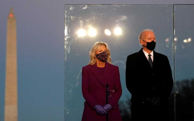 U.S. President-elect Joe Biden and his wife Jill Biden attend a coronavirus disease memorial event at the Lincoln Memorial in Washington, Jan 19, 2021. REUTERS
