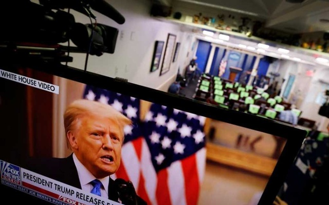 US President Donald Trump makes remarks on a television monitor from the White House Briefing Room during his last day in office, in Washington, DC US, January 19, 2021. REUTERS/Carlos Barria