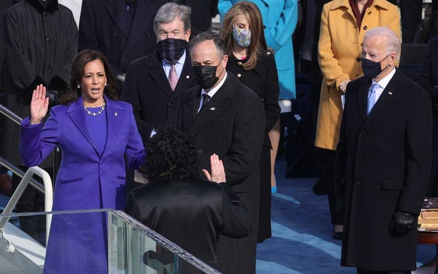 Kamala Harris is sworn as US Vice-President next to her husband Doug Emhoff and Joe Biden during the inauguration of Joe Biden as the 46th President of the United States on the West Front of the US Capitol in Washington, US, January 20, 2021. Reuters