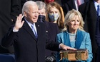 Joe Biden is sworn in as the 46th President of the United States as his wife Jill Biden holds a bible on the West Front of the US Capitol in Washington, US, January 20, 2021. Reuters