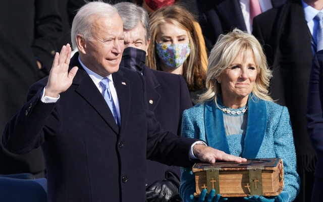 Joe Biden is sworn in as the 46th president of the United States by Chief Justice John Roberts as Jill Biden holds the Bible during the 59th Presidential Inauguration at the U.S. Capitol in Washington, Jan 20, 2021. REUTERS