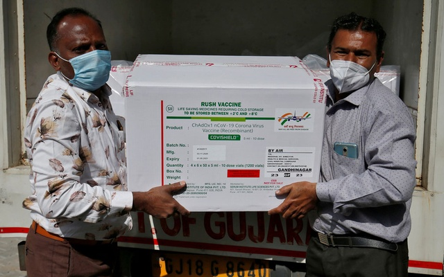 Officials unload boxes containing vials of COVISHIELD, a coronavirus disease (COVID-19) vaccine manufactured by Serum Institute of India, after a consignment of the vaccines arrived from the western city of Pune for its distribution, outside a vaccination storage centre in Ahmedabad, India, January 12, 2021. Reuters