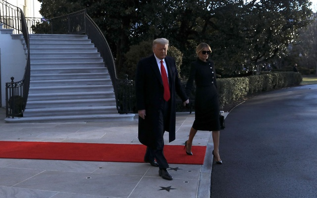 US President Donald Trump and first lady Melania Trump leave the White House to board Marine One ahead of the inauguration of president-elect Joe Biden, in Washington, US, January 20, 2021. Reuters