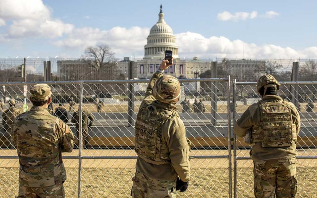 A member of the National Guard uses his smartphone to record the scene at the US Capitol during the inauguration of President Joe Biden on Wednesday, Jan. 20, 2021. (Jason Andrew/The New York Times)