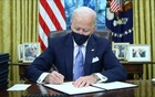 US President Joe Biden signs executive orders in the Oval Office of the White House in Washington, after his inauguration as the 46th President of the United States, US, January 20, 2021. REUTERS