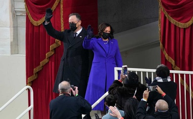 """Kamala Harris and her husband Doug Emhoff arrive for her inauguration to become Vice President of the United States of America, at the Capitol in Washington Jan 20, 2021. The theme of the Biden inauguration was """"America United,"""" and the colour of the day seemed to be purple — the shade that bridges the divide by bringing both colours together (not to mention one of the original signature colours of the suffragists, whose dreams are now being realised with the first woman vice president). (Erin Schaff/The New York Times)"""