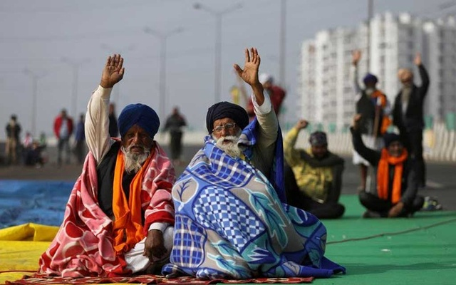 FILE PHOTO: Farmers take part in a protest against the newly passed farm laws on the outskirts of Delhi, India, December 17, 2020. REUTERS/Anushree Fadnavis