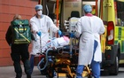 Health care workers transport a patient at the Royal London Hospital, as the spread of the coronavirus disease (COVID-19) continues, in London, Britain, Jan 19, 2021. REUTERS