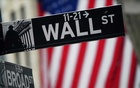 A Wall Street sign is pictured outside the New York Stock Exchange in the Manhattan borough of New York City, New York, US, October 2, 2020. REUTERS