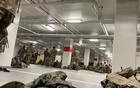 A photo provided to The New York Times shows National Guard soldiers resting in the parking garage of the Thurgood Marshall Federal Judiciary Building in Washington on Thursday, Jan. 21, 2021. National Guard troops brought in to protect Joe Biden's inauguration were ordered to sleep in the unheated garage hours after being booted from the Capitol on Thursday, prompting an uproar among lawmakers who scrambled to move them back. (Via The New York Times)