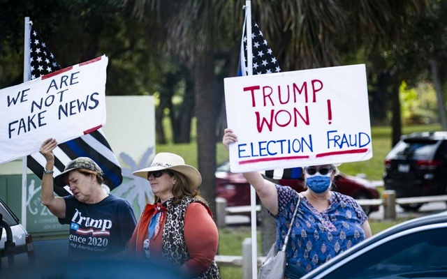 Supporters of outgoing President Donald Trump line the street as his motorcade is driven to his Mar-a-Lago resort in Palm Beach, Fla, shortly before the inauguration of President Joe Biden on Wednesday, Jan 20, 2021. The New York Times