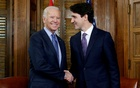 Canada's Prime Minister Justin Trudeau (R) shakes hands with US President Joe Biden during a meeting in Trudeau's office on Parliament Hill in Ottawa, Ontario, Canada, Dec 9, 2016. REUTERS/FILE