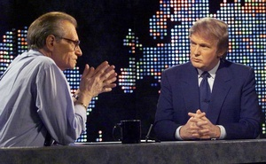 Billionaire real estate developer Donald Trump (R) talks with host Larry King after taping a segment of King's CNN talk show, in New York, US, Oct 7, 1999. REUTERS
