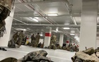 A photo provided to The New York Times shows National Guard soldiers resting in the parking garage of the Thurgood Marshall Federal Judiciary Building in Washington on Thursday, Jan 21, 2021. National Guard troops brought in to protect Joe Biden's inauguration were ordered to sleep in the unheated garage hours after being booted from the Capitol on Thursday, prompting an uproar among lawmakers who scrambled to move them back. The New York Times