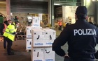 Workers check boxes of Pfizer-BioNtech COVID-19 vaccines in a warehouse of Ciampino airport in Rome, Italy, in this still image taken from a video taken December 30, 2020. Polizia di Stato/Handout via REUTERS