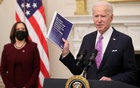 US President Joe Biden speaks about his administration's plans to fight the coronavirus disease (COVID-19) pandemic during a COVID-19 response event as Vice President Kamala Harris listens at the White House in Washington, US, January 21, 2021. REUTERS
