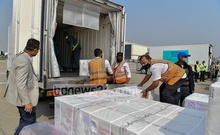Workers loading the containers of Oxford-AstraZeneca COVID-19 vaccines, imported from India's Serum Institute, on refrigerated vans at Shahjalal International Airport in Dhaka on Jan 25, 2021. Photo: PID