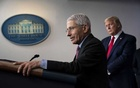 FILE — Dr Anthony Fauci makes remarks as President Donald Trump looks on during the daily White House Coronavirus briefing at the White House, on April 22, 2020. From denialism to death threats, Dr Anthony Fauci describes a fraught year as an adviser to President Donald Trump on the COVID-19 pandemic. (Doug Mills/The New York Times)