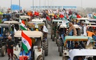 Farmers participate in a tractor rally to protest against the newly passed farm bills, on a highway on the outskirts of New Delhi, India, January 7, 2021. REUTERS