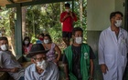 Brazilian indigenous people waited in Sao Paulo on Jan 20, 2021, to receive the COVID-19 vaccine from the Chinese company Sinovac. Brazilian officials have complained that Chinese companies have been slow to ship the doses and ingredients. (Victor Moriyama/The New York Times)