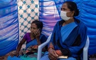 Reena Jani, 34, a health worker, waits to receive the vaccine developed by Oxford/AstraZeneca at Mathalput Community Health Centre, during the coronavirus disease (COVID-19) pandemic, in Koraput, India, Jan 16, 2021. REUTERS