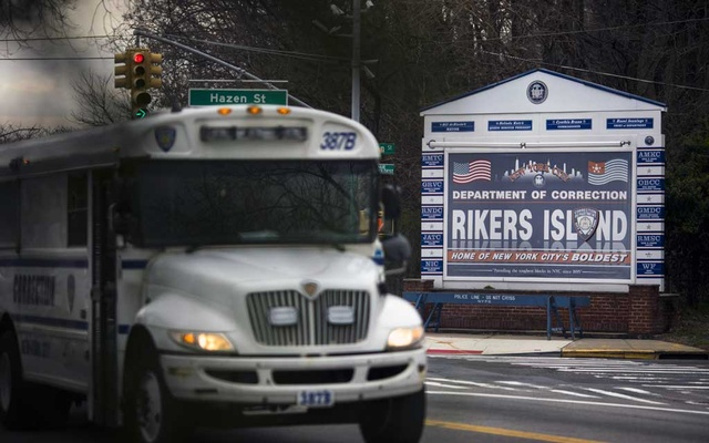 A Department of Corrections bus crosses the bridge from the Rikers Island jail complex into Queens on March 20, 2020. The New York Times