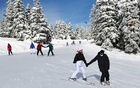 People ski amid the spread of the coronavirus disease (COVID-19) in the western mountain resort of Uludag in Bursa, Turkey January 23, 2021. REUTERS