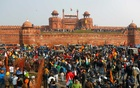 Farmers gather in front of the historic Red Fort during a protest against farm laws introduced by the government, in Delhi, India, Jan 26, 2021. REUTERS